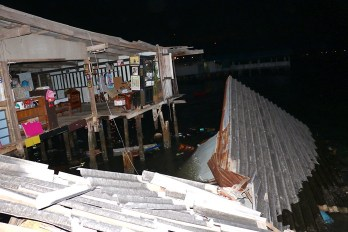 Rotten stilt house collapsed in water