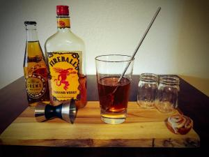 Making the Cinnamon Roll Shot by combining Fireball Whisky and Boylan's Creme Soda in a mixing glass.