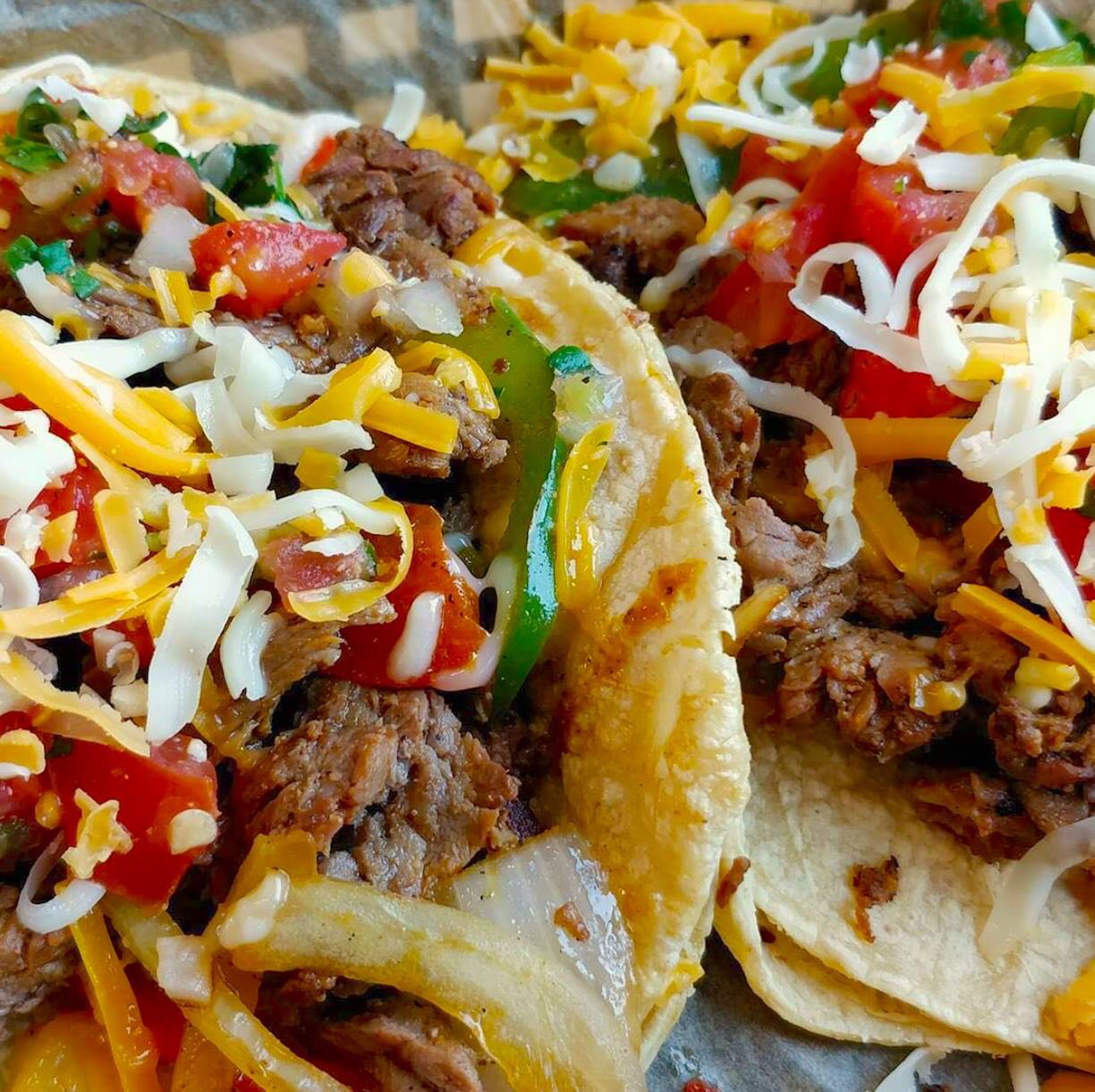Torchy's Tacos Beef Fajita Taco made with MARINATED & GRILLED BEEF, GRILLED ONIONS & PEPPERS, PICO DE GALLO & CHEDDAR JACK CHEESE WITH ROJA SAUCE ON YOUR CHOICE OF TORTILLA.
