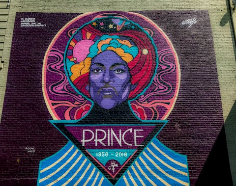 Across the street from Torchy's Tacos on Broadway in Denver, CO is a tribute mural to the late Prince. The Prince mural is painted by El Marsito, Zak Wilson, Samuel Shoho and B.O.A. Graphics in Denver, CO.