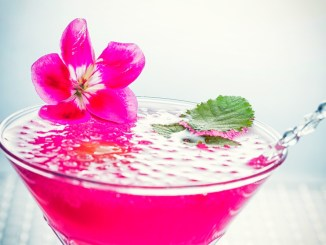 A bright fuchsia martini bursting with island flavors! This delicious tropical Staycation in a glass is made with Cruzan Guava rum, Monin Coconut Syrup, Monin Desert Pear Syrup, lime juice, pineapple juice, and coconut water. Then topped with beautiful cocktail caviar and edible flowers.