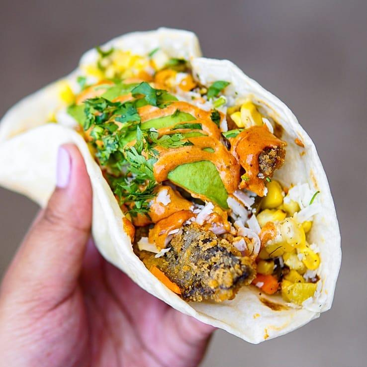 Torchy's Independent taco made with FRIED PORTOBELLO MUSHROOMS, REFRIED BLACK BEANS, GRILLED CORN, ESCABECHE CARROTS, COTIJA CHEESE, CILANTRO & AVOCADO WITH ANCHO AIOLI ON A FLOUR TORTILLA.