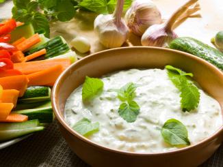 Homemade garlic blue cheese dressing served with carrots, cucumbers, and celery