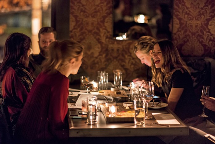 Diners enjoy the delectable menu