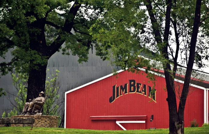 A statue of Booker Now (and his dog, Dot) keeps watch at the Jim Beam American Stillhouse in Clermont, Kentucky.