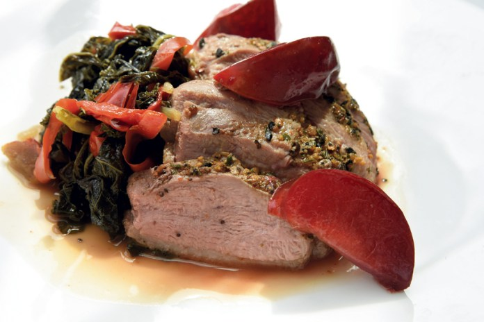 Duck breast with collard greens and roasted peaches