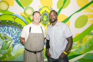 "Chicago Bears cornerback Charles ""Peanut"" Tillman and ""MasterChef"" judge Graham Elliot celebrate art and Chicago culture at the preview of the Sierra Mist® Exquisite Collaboration Billboard Project on September 17, 2014 in Chicago, Illinois. The billboard – a collaborative effort between five local Chicago artists – will be photographed and placed in 15 locations throughout the city in late September."