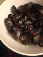 Live mussels cooked in buttery broth