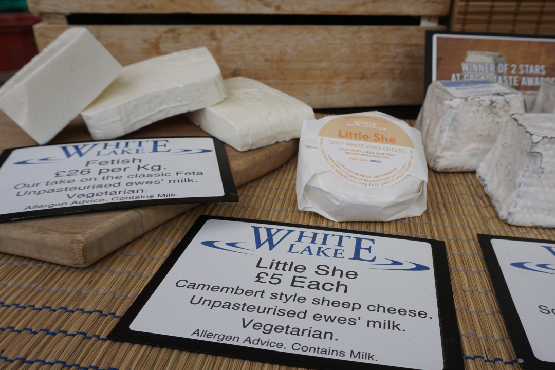 Range of cheeses on table by White Lake