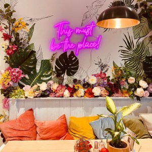 table in cafe with flowers on wall