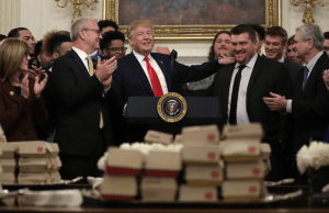 Trump once again caters football champ's with fast food