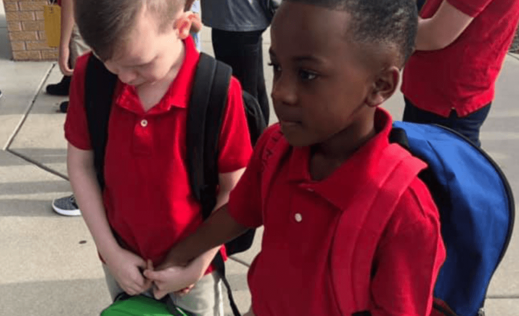 Boy Holds Hands, Calms Crying Classmate With Autism On First Day of School