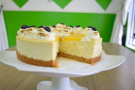 Lemon Cheese Cake cut out against green wall