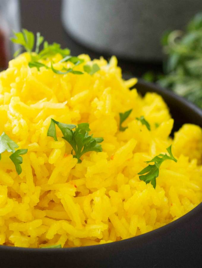 A closer shot of a serving of Saffron Rice in a bowl.