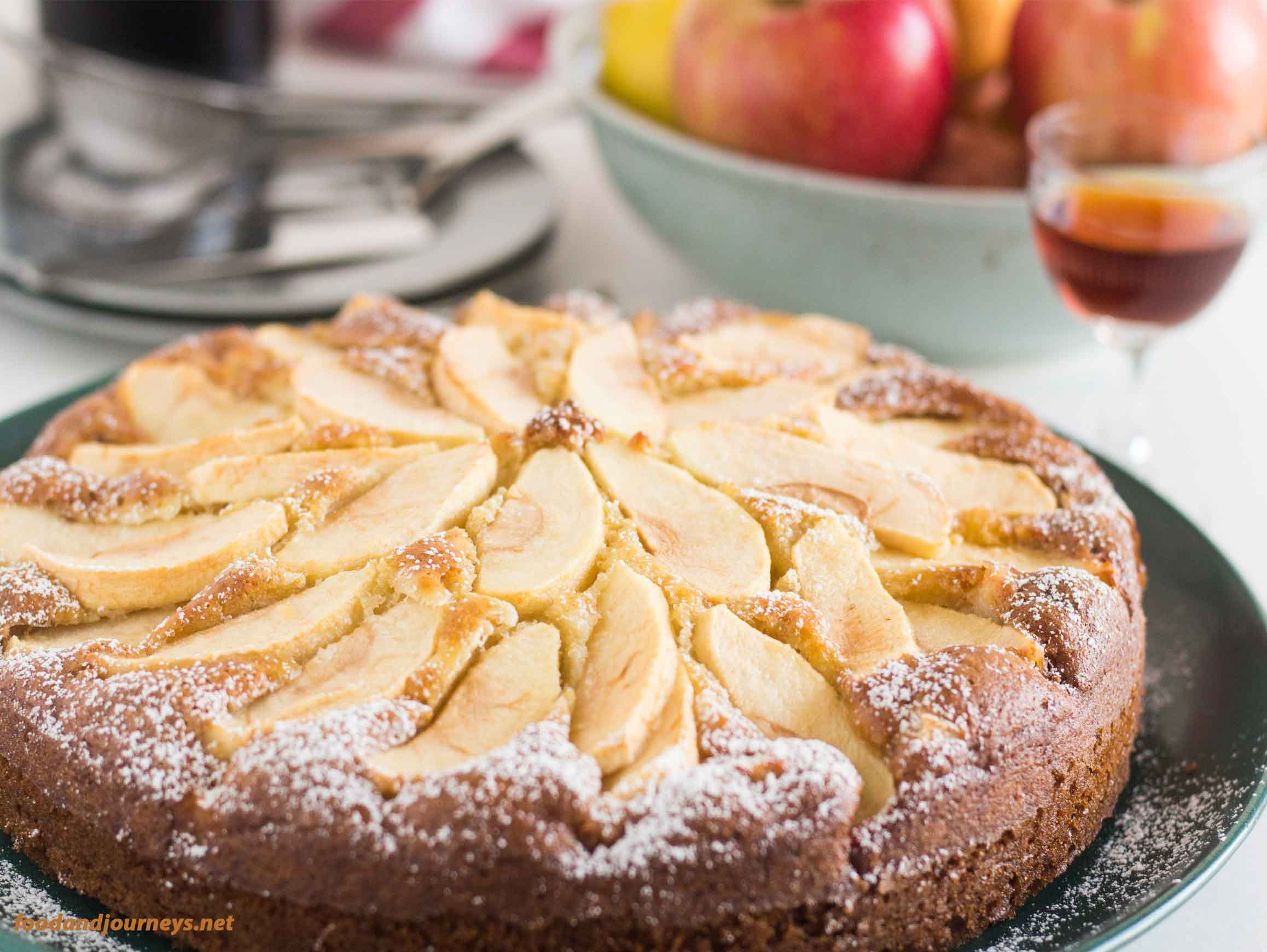 Side shot of Tuscan Apple Cake showing the apples on top|foodandjourneys.net
