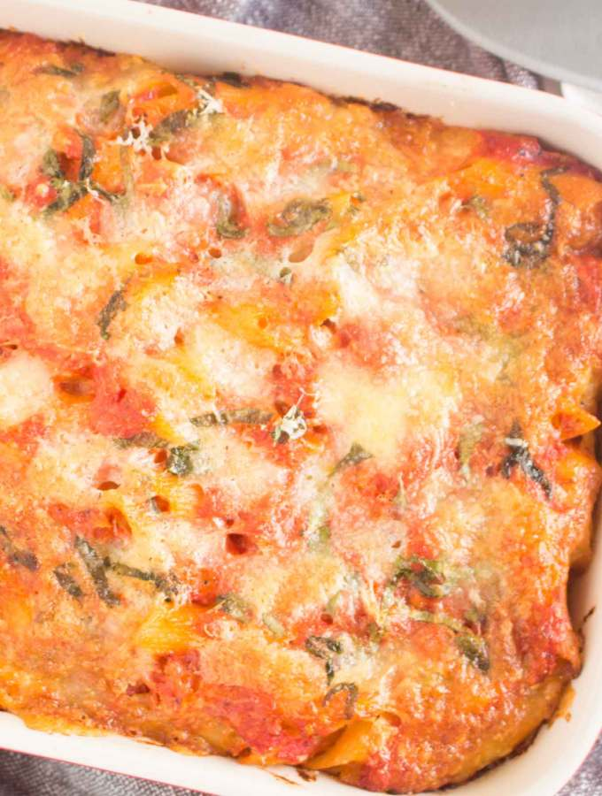 Feature image for penne alla sorrentina showing the entire top of the dish.