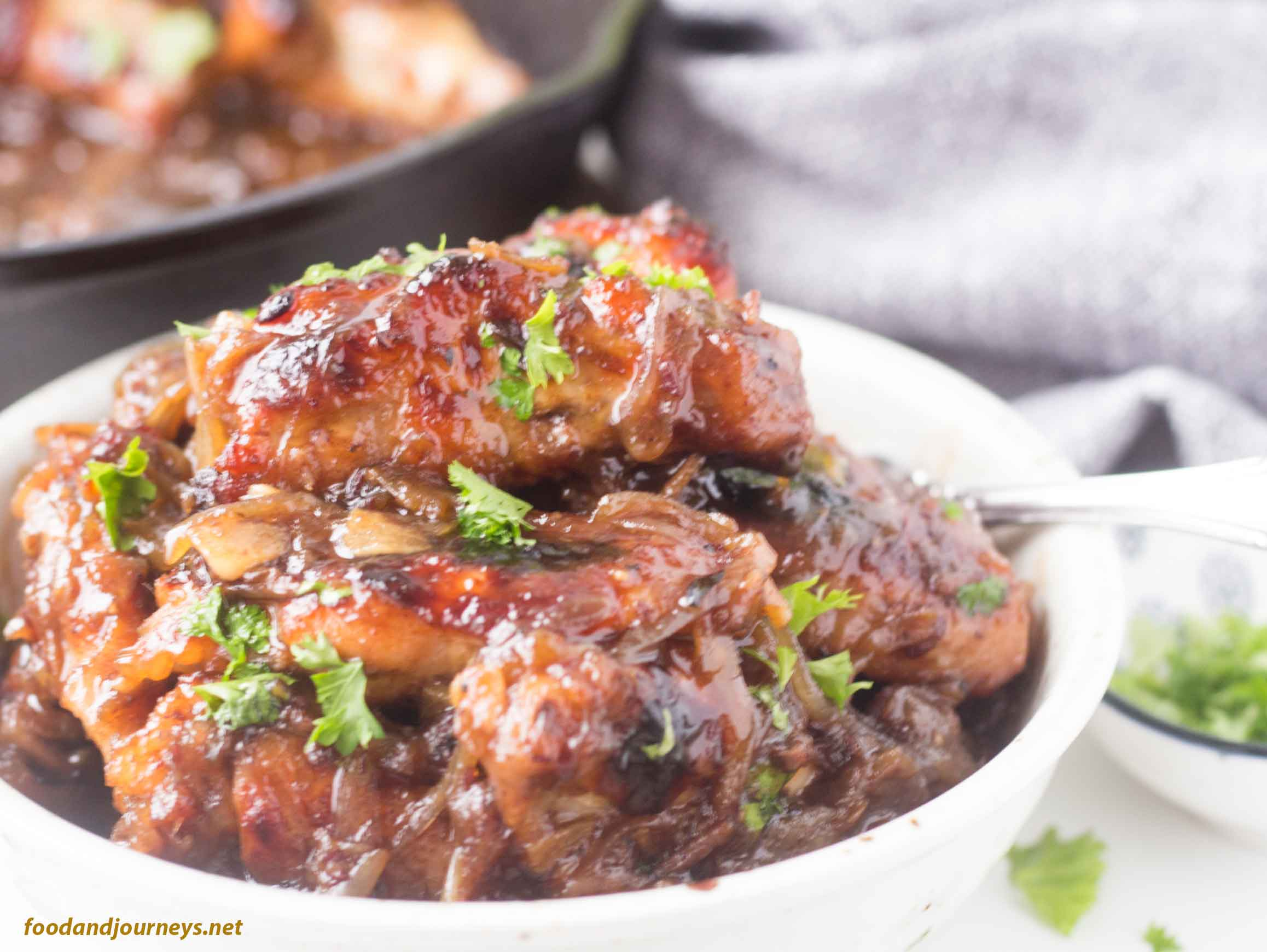 Image of Spanish Sweet & Sticky Wings on a plate, ready for serving.