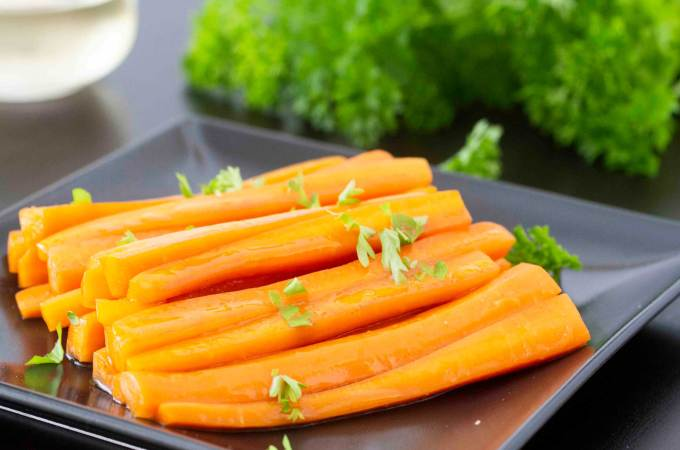 A serving of Carrots with Marsala (Carote al Marsala), sprinkled with parsley.