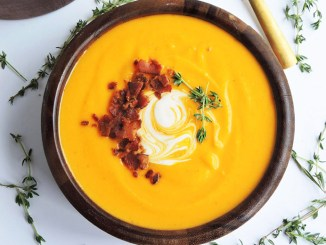 A bowl of Brown Butter Bacon Butternut Squash Soup shot from above