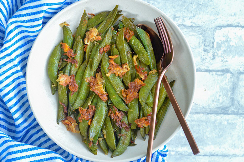 Parmesan Roasted Snap Peas in a bowl