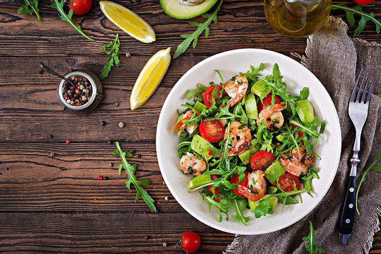Fresh salad bowl with shrimp, tomato, avocado