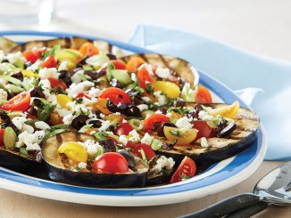 Plate of grilled eggplant with tomatoes and feta