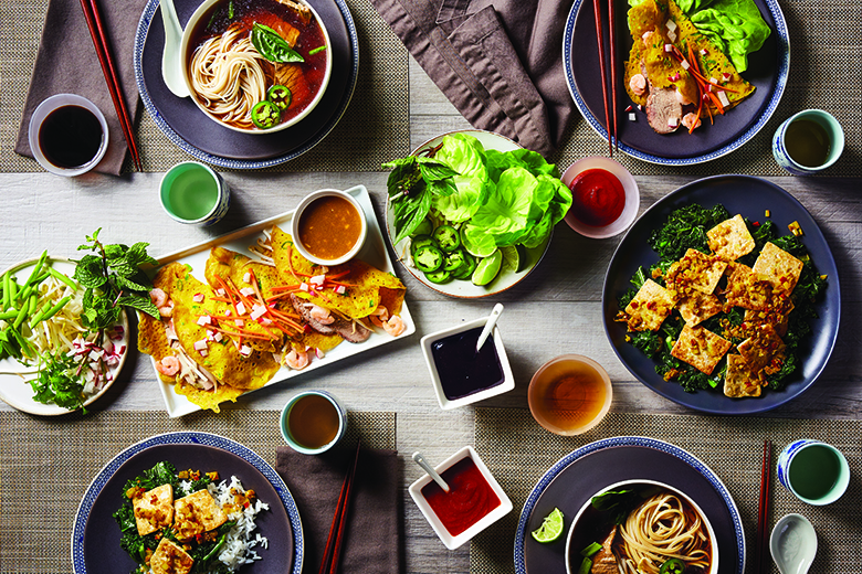 A table full of Vietnamese dishes