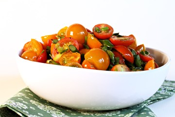 Flash-sautéed cherry tomatoes with garlic scapes and chives