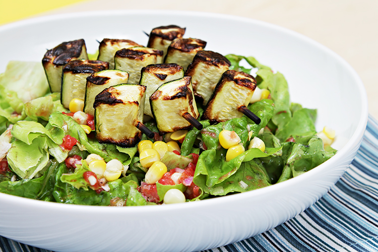 Boston lettuce with corn, tomato vinaigrette and grilled zucchini skewers