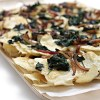Potato nachos with smoked Raclette-wilted spinach and caramelized red onion