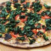 Grilled kale pizza with smoked Gruyère, sweet corn and chili oil