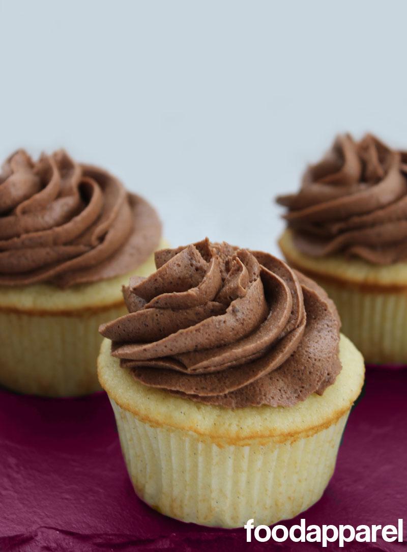 Vanilla Bean Cupcakes with Fudgy Chocolate Frosting at FoodApparel.com