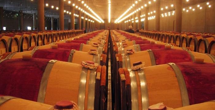 Wine barrels in wine warehouse