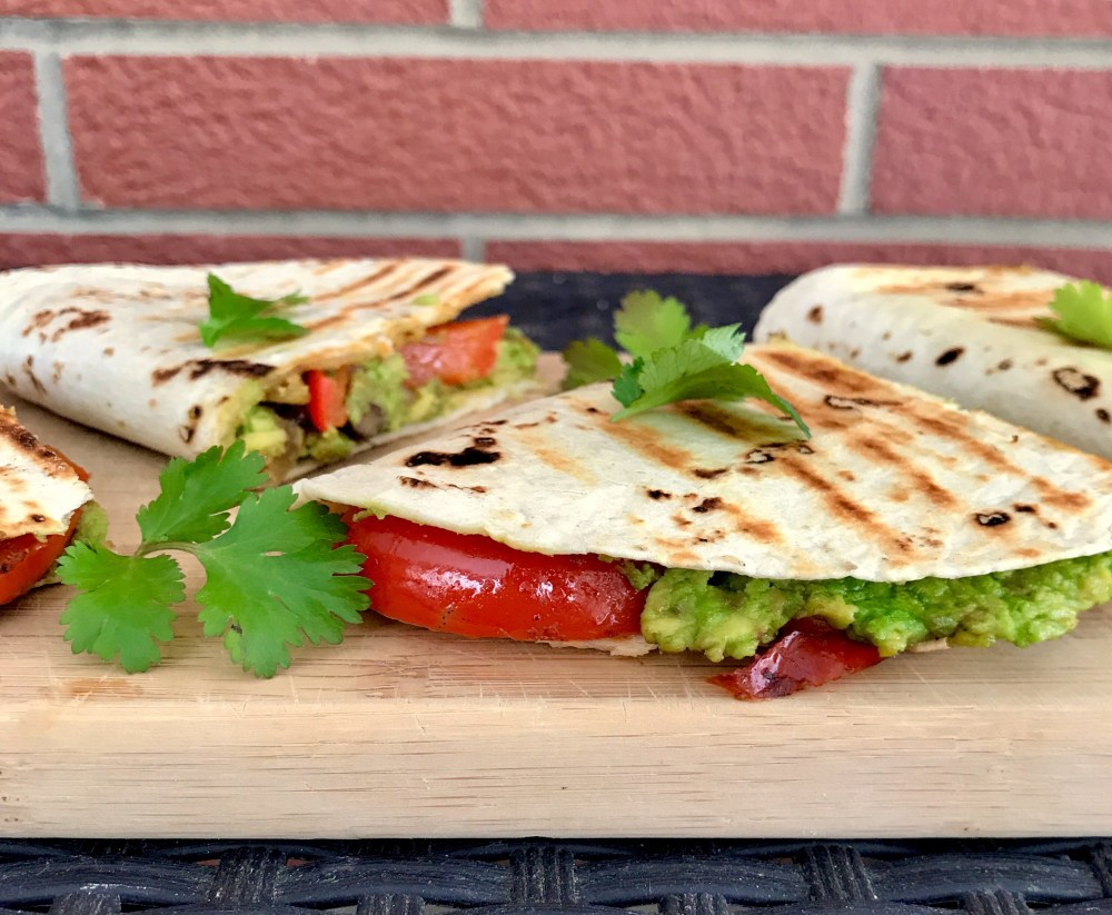 vegan avocado quesadillas filled with vegetables and black beans
