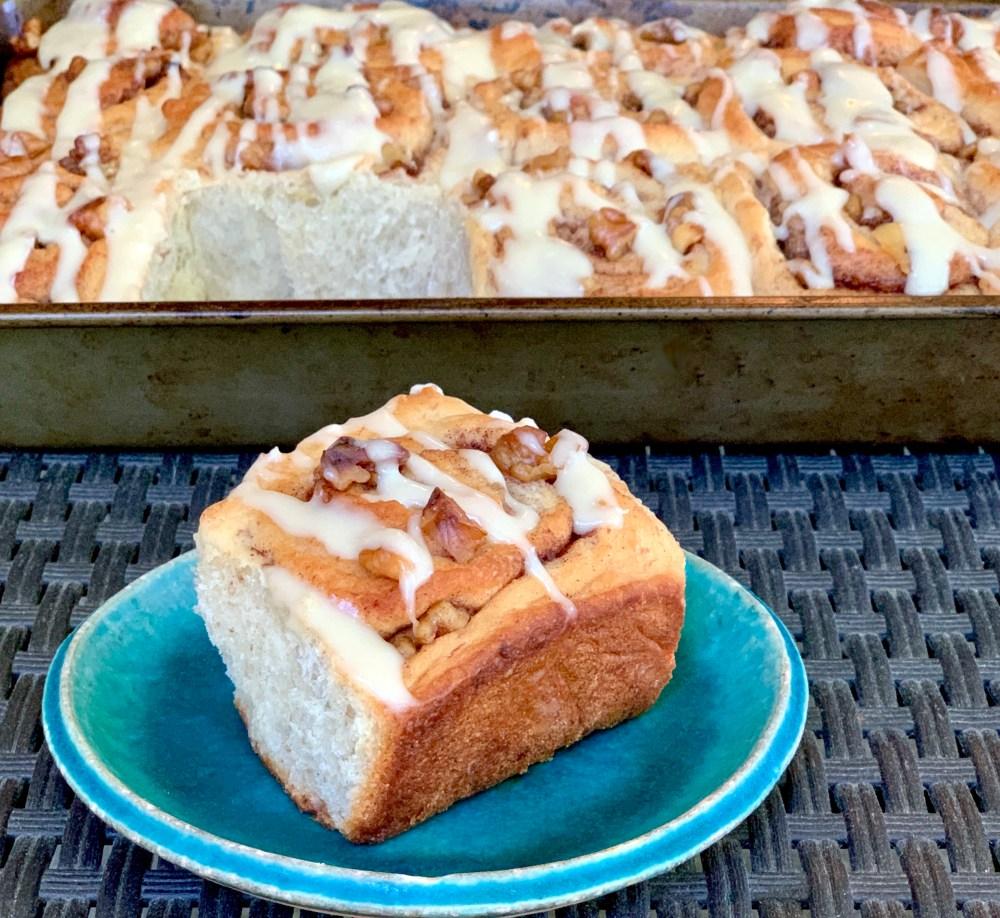 Vegan banana bread cinnamon rolls with walnuts and cream cheese icing