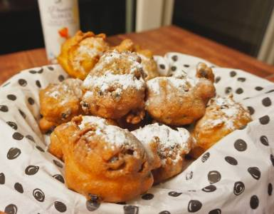 oliebollen - dutch donuts - with and without raisins and with icing sugar
