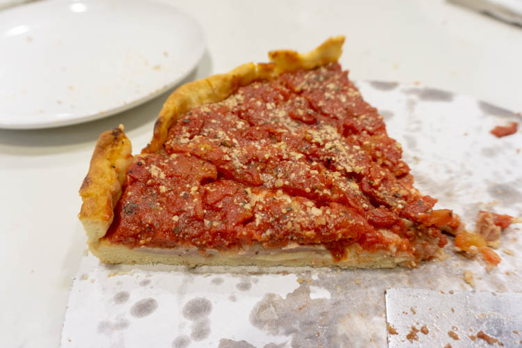deep dish pizza with a cheese barrier
