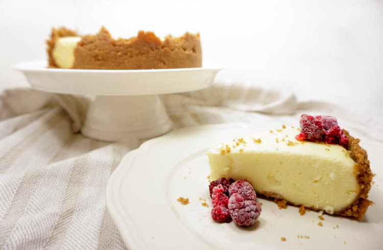 slice of instant pot cheesecake with some raspberries (2)