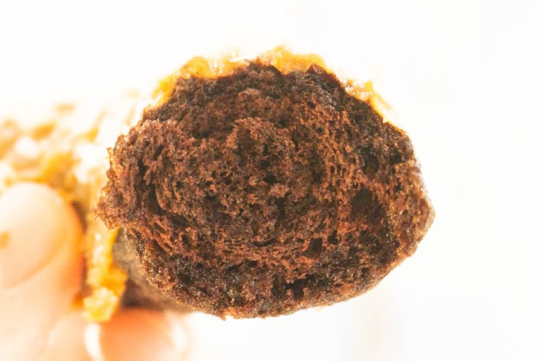 inside of chocolate cake donut bitten in half