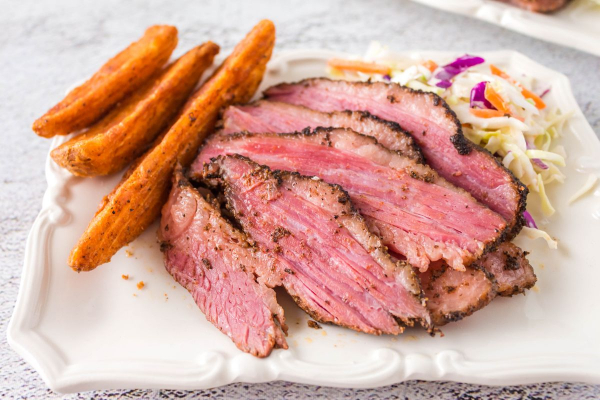 Smoked Corned Beef Brisket on plate with potato wedges