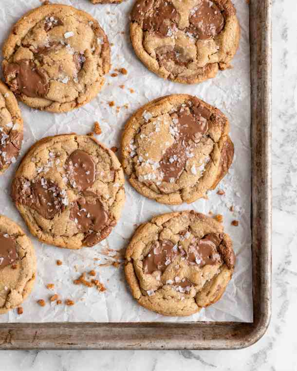 Chewy golden Toffee Milk Chocolate Chip Cookies on baking sheet