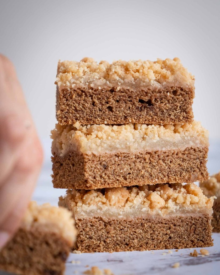 stack of 3 cake bars layered with apple sauce and golden crumbs