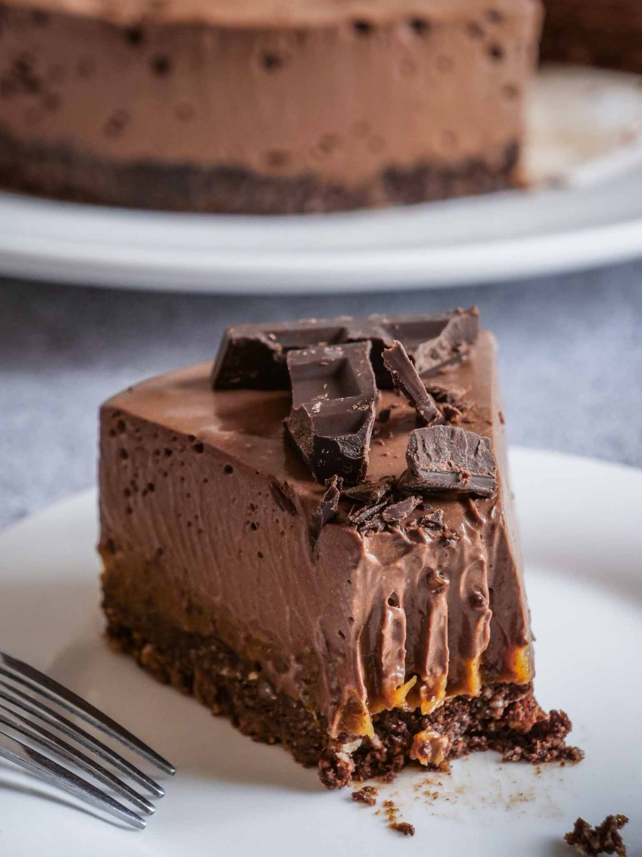 slice of homemade vegan gluten-free healthy mars chocolate cheesecake with layers of caramel and chocolate