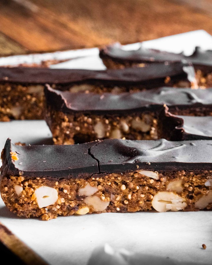 rows of peanut butter chocolate bars laying on greaseproof paper