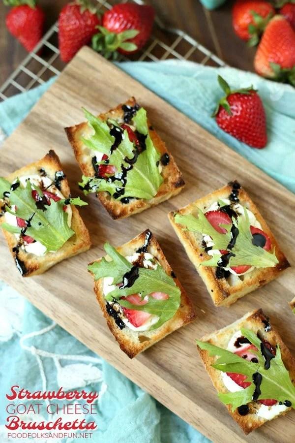 Strawberry Bruschetta on a wooden serving board.