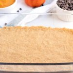 Press the crust mixture into the greased 9x13-inch pan.