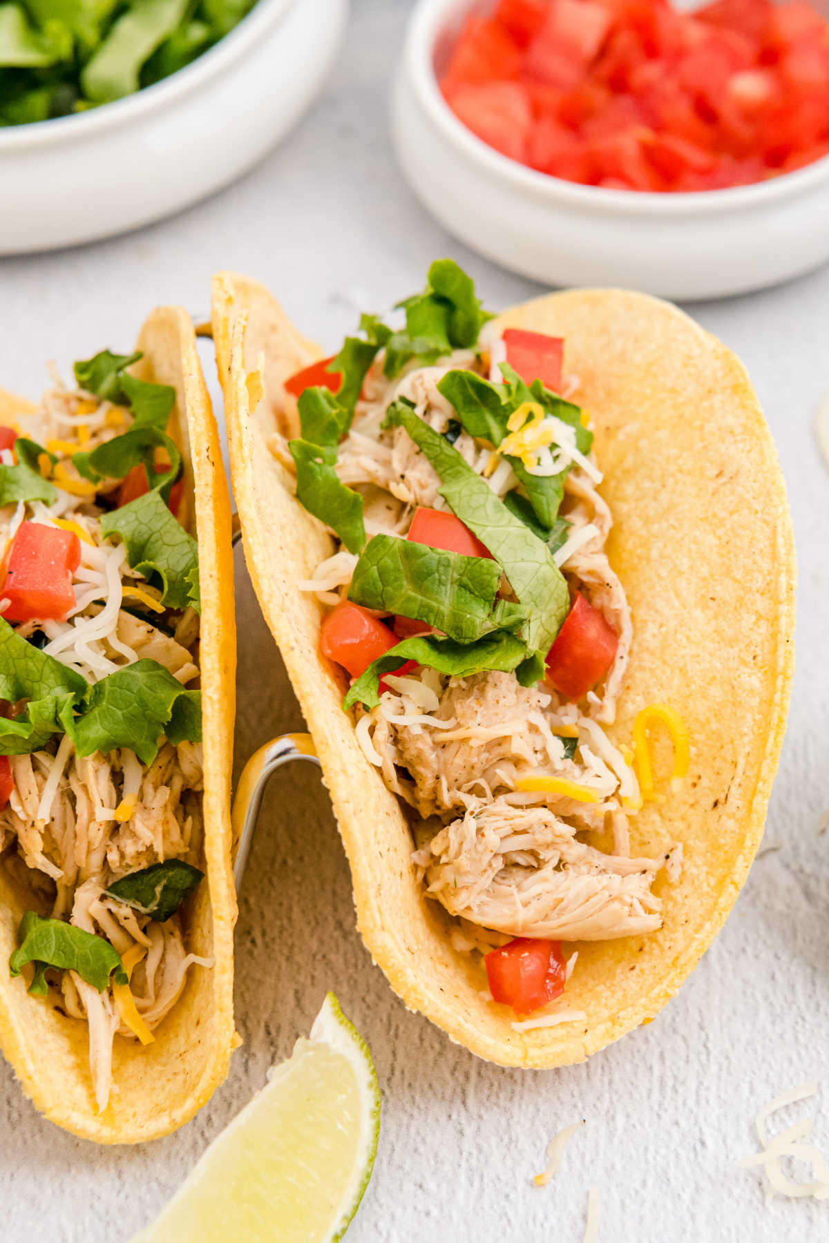 These Crockpot Shredded Chicken Tacos are my go-to weeknight dinner. They're juicy, flavorful, and SO easy to make. via @foodfolksandfun