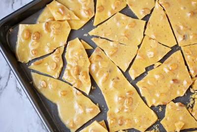 A close up, overhead picture of peanut brittle.