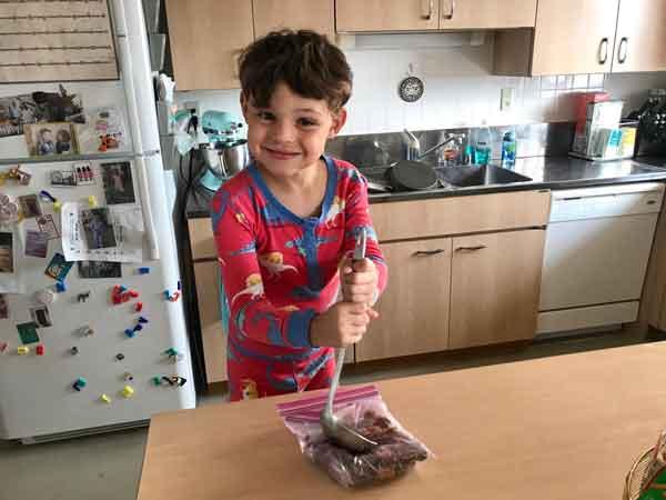 A child helping make Butterfinger Scotcheroos