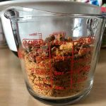 Crushed up Butterfingers in a liquid measuring cup